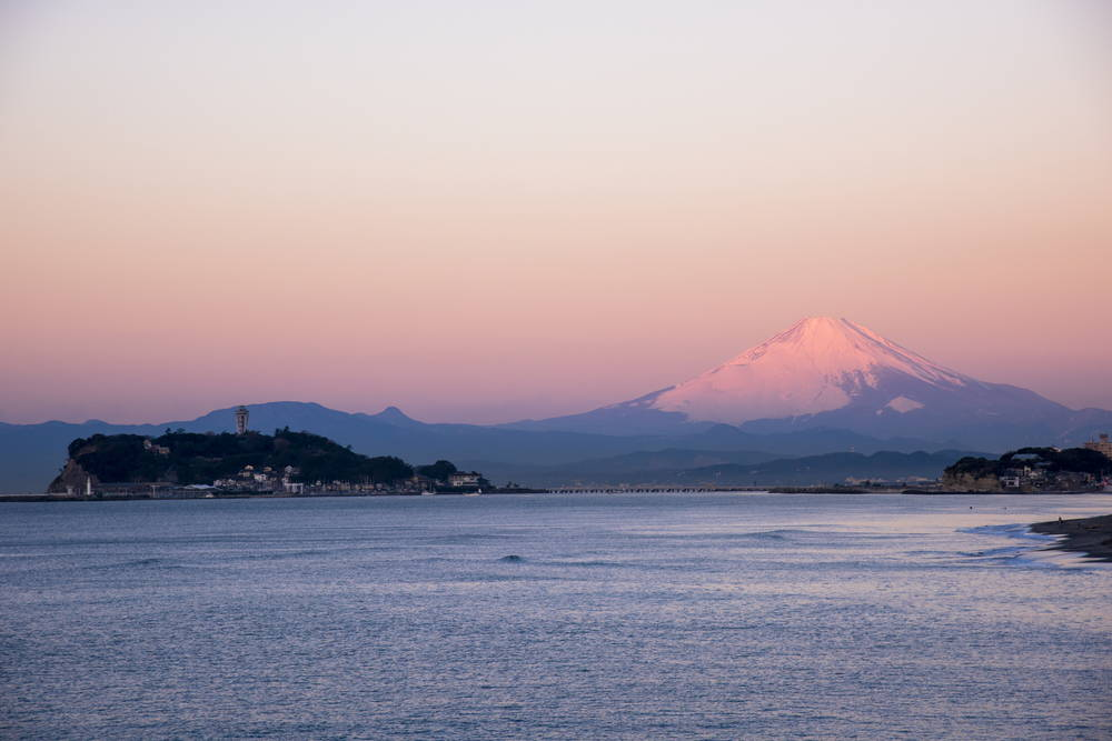 View of Enoshima, Japan at Dawn with Mt. Fuji in the distance