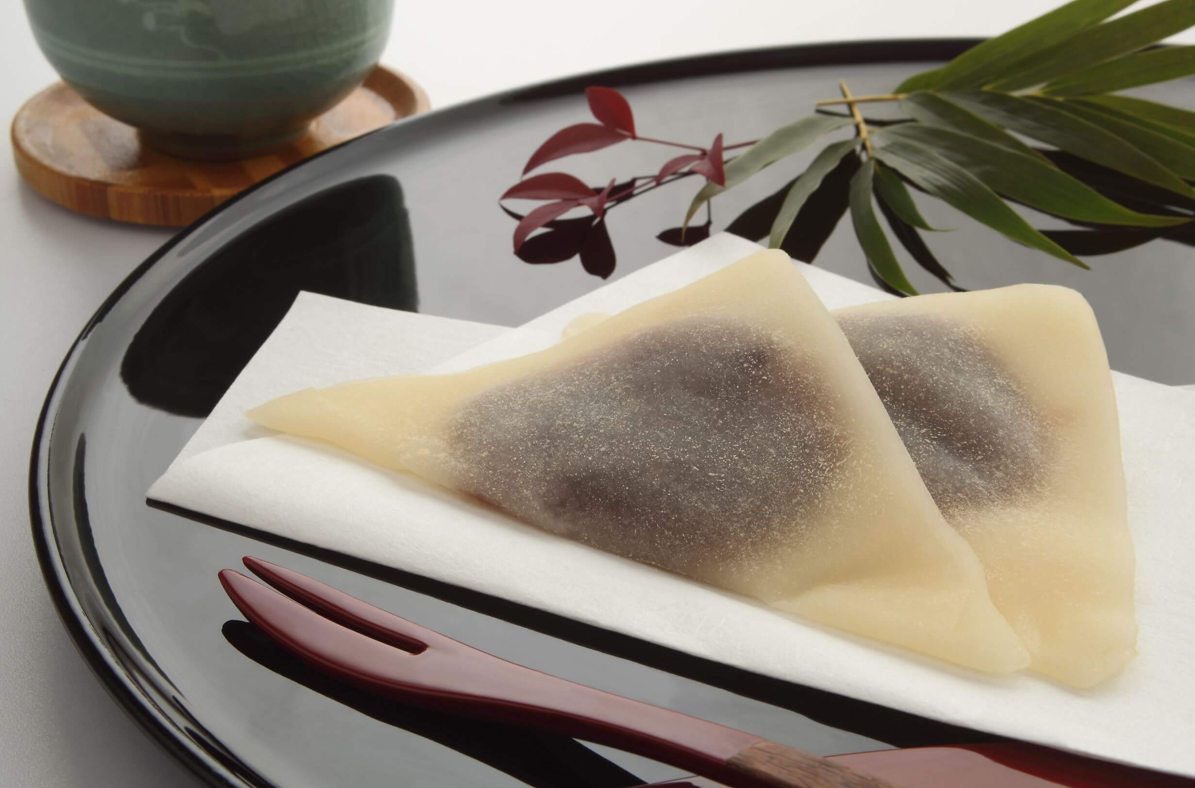 Yatsuhashi, thin mochi folded in half and filled with red bean paste